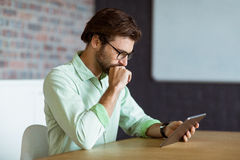 Male business executive using digital tablet Stock Image