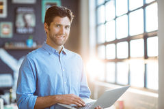 Male business executive using laptop Stock Images