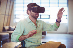 Male business executive using virtual glasses. In office Royalty Free Stock Image