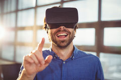 Male business executive using virtual reality headset. In office Royalty Free Stock Images