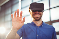 Male business executive using virtual reality headset. In office Royalty Free Stock Photography