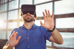 Male business executive using virtual reality headset. In office Royalty Free Stock Photos
