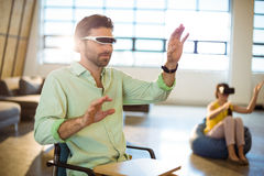 Male business executive using virtual reality video glasses Royalty Free Stock Photography