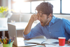 Male business executive yawning Royalty Free Stock Photo
