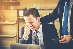 Male business man is being blamed by a boss who holds a calculator. royalty free stock images