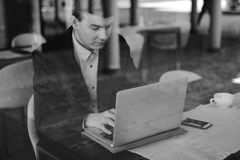 Male business man using his laptop Stock Photography