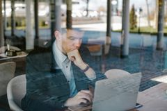 Male business man using his laptop Royalty Free Stock Image