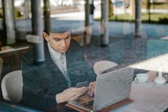 Male business man using his laptop Stock Photos
