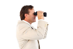 Male business manager with binoculars Royalty Free Stock Image