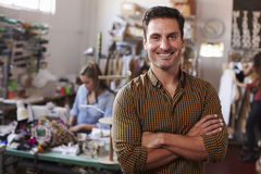 Male business owner in clothing design studio, arms crossed royalty free stock photo