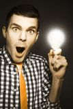 Male Business Person With Light Bulb In Hand Stock Images