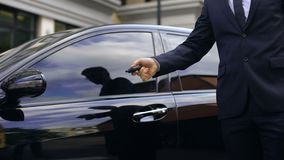 Male in business suit getting out expensive car and locking it, promotion. Stock footage stock video footage