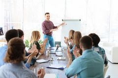 Male business trainer giving lecture. In office royalty free stock image