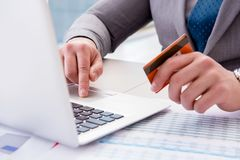 The male businessman doing online shopping with credit card. Male businessman doing online shopping with credit card Royalty Free Stock Images