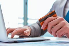 The male businessman doing online shopping with credit card. Male businessman doing online shopping with credit card Royalty Free Stock Image