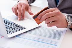 The male businessman doing online shopping with credit card. Male businessman doing online shopping with credit card Stock Photos