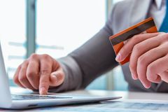 The male businessman doing online shopping with credit card. Male businessman doing online shopping with credit card Royalty Free Stock Photos