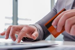 The male businessman doing online shopping with credit card. Male businessman doing online shopping with credit card Royalty Free Stock Photography