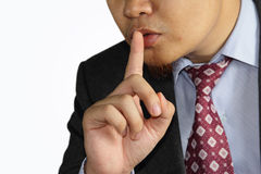 Male businessman finger mouth shh gesture Stock Image