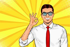 Male businessman in glasses winks and shows okay or OK gesture. Pop art retro vector illustration. Success concept. Invitation poster vector illustration