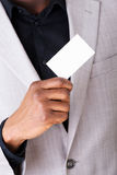 Male businessman holding a business card. Stock Image