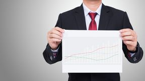 Male businessman holding white paper showing graph Royalty Free Stock Photography