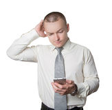 Male businessman with phone. And an expression of puzzlement Stock Photo