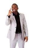 Male businessman poiting high in a smile. Stock Photography