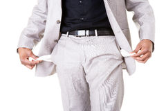 Male businessman showing open pockets. Stock Photo