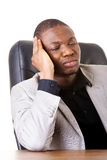 Male businessman sitting, bored. Royalty Free Stock Photography
