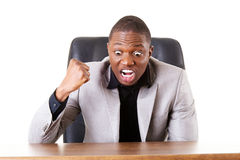 Male businessman sitting in a chair, angry. Stock Photo