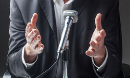 Male businessman speaking to the public on micro stock images