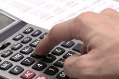 Male businessman using a calculator. Closeup Stock Photos