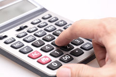 Male businessman using a calculator. Closeup Royalty Free Stock Photos