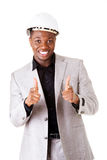 Male businessman wearing a helmet. Pointing. Stock Photo