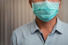 Male businessman who closes the protective mask Due to illness and cough royalty free stock photography