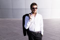 Male businessman or worker in black suit stock photo