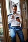 Businessperson on cell phone calling business partner Stock Image