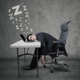 Male businessperson sleeping at table Stock Photos