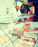 Male butcher in kosher section at supermarket. Portrait of cheerful male butcher in kosher section at supermarket Stock Images