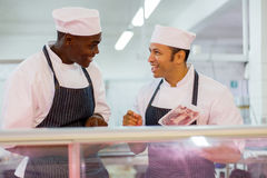 Male butchers discussing work Royalty Free Stock Image