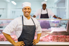 Male butchery owner. Smiling male butchery owner in the shop royalty free stock photo