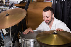 Male buyer choosing drums and accessories Royalty Free Stock Image