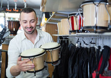 Male buyer choosing drums and accessories Royalty Free Stock Photo
