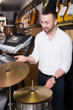 Male buyer selecting drums and accessories Royalty Free Stock Photos