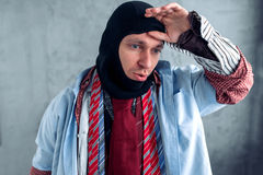 Male buyer trying on balaklava at the clothes shop Stock Photography