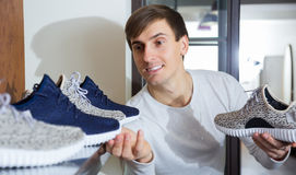 Male buying summer shoes. In a shoe shop Royalty Free Stock Photography