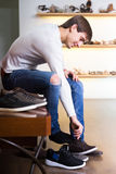 Male buying summer shoes. In a shoe store Royalty Free Stock Photos