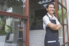 Male cafe worker smiling Stock Image