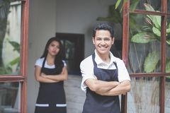 Male cafe worker smiling Royalty Free Stock Images